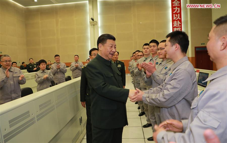 Chinese President Xi Jinping (L, front), also general secretary of the Communist Party of China Central Committee and chairman of the Central Military Commission, talks with scientists and technicians, asking them about their research, work and lives, as he visits a military base in southwest China's Sichuan Province, Feb. 10, 2018. Xi extended festival greetings to all officers and soldiers of the People's Liberation Army and the armed police force, and all militia and reserve personnel. (Xinhua/Li Gang)<br/>