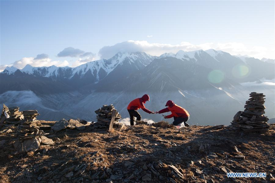 Scientific researchers from the alpine ecosystem observation and experiment station of Gongga Mountain under the Chinese Academy of Sciences collect plant samples on the west slope of Gongga Mountain, southwest China's Sichuan Province, Nov. 23, 2017. China's annual political sessions of the National People's Congress (NPC) and the National Committee of the Chinese People's Political Consultative Conference (CPPCC) are scheduled to convene in March, 2018. During the two sessions, development agendas will be reviewed and discussed, and key policies will be adopted. Year 2018 marks the first year of fully implementing the spirit of the 19th National Congress of the Communist Party of China, which vowed to pursue the vision of innovative, coordinated, green, and open development that is for everyone. The CPC congress stressed that building an ecological civilization is vital to sustain the Chinese nation's development, &quot;we must realize that lucid waters and lush mountains are invaluable assets.&quot; (Xinhua/Jin Liwang)<br/>