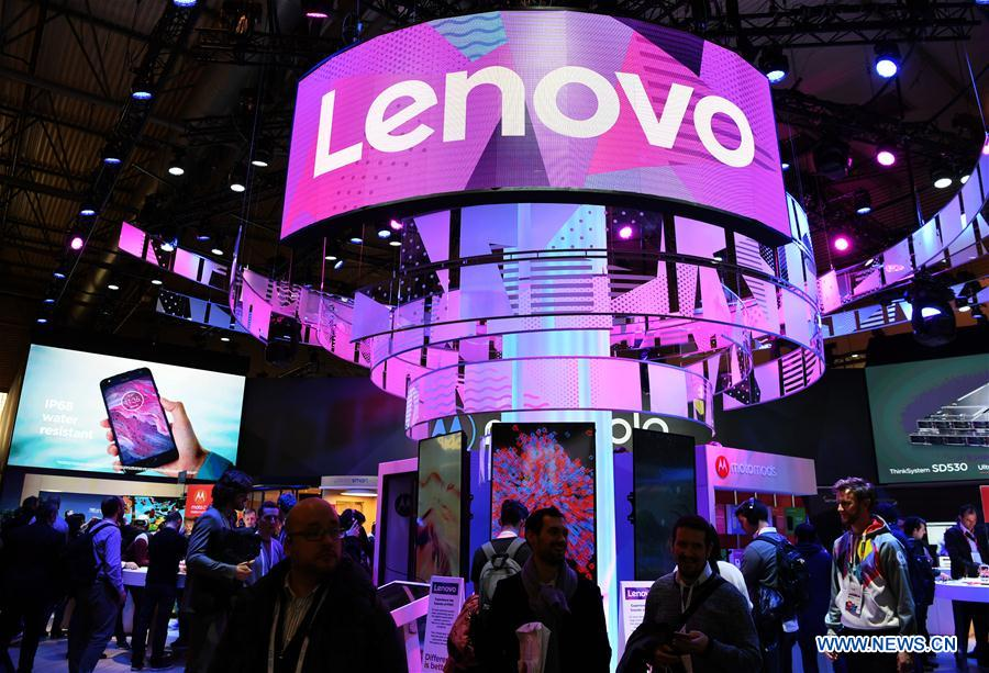 People visit Lenovo's booth during the closing day of the 2018 Mobile World Congress (MWC) in Barcelona, Spain, on March 1, 2018. The four-day 2018 MWC closed here on Thursday. (Xinhua/Guo Qiuda)
