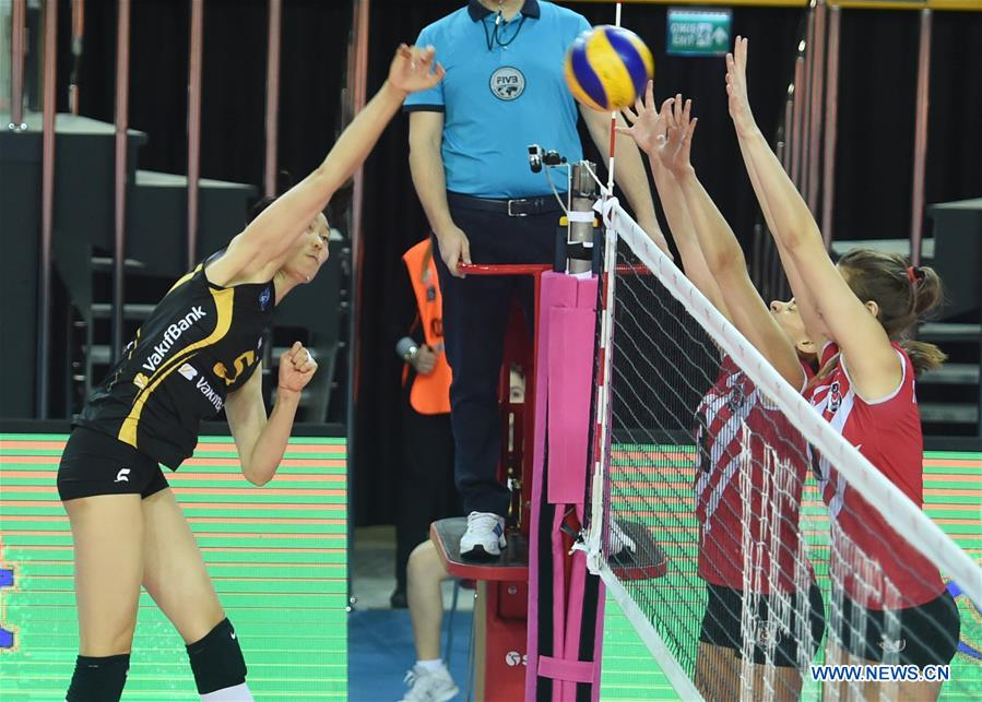 Vakifbank's Zhu Ting (L) spikes during the second leg match between Vakifbank and Besiktas of the 2017-2018 Turkish Women Volleyball League Playoffs Quarter Final in Istanbul, Turkey, on March 6, 2018. Vakifbank won 3-0 and was qualified for the semifinal. (Xinhua/He Canling)<br/>