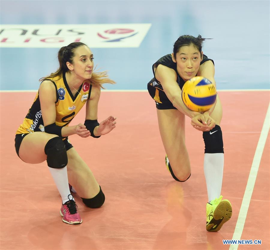 Vakifbank's Zhu Ting (R) saves the ball during the second leg match between Vakifbank and Besiktas of the 2017-2018 Turkish Women Volleyball League Playoffs Quarter Final in Istanbul, Turkey, on March 6, 2018. Vakifbank won 3-0 and was qualified for the semifinal. (Xinhua/He Canling)