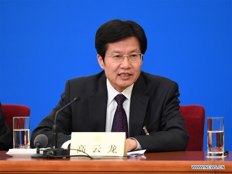 Gao Yunlong, chairman of the All-China Federation of Industry and Commerce, speaks at a press conference for the first session of the 13th National Committee of the Chinese People's Political Consultative Conference (CPPCC) in Beijing, capital of China, March 6, 2018. (Xinhua/Shen Hong)<br/>