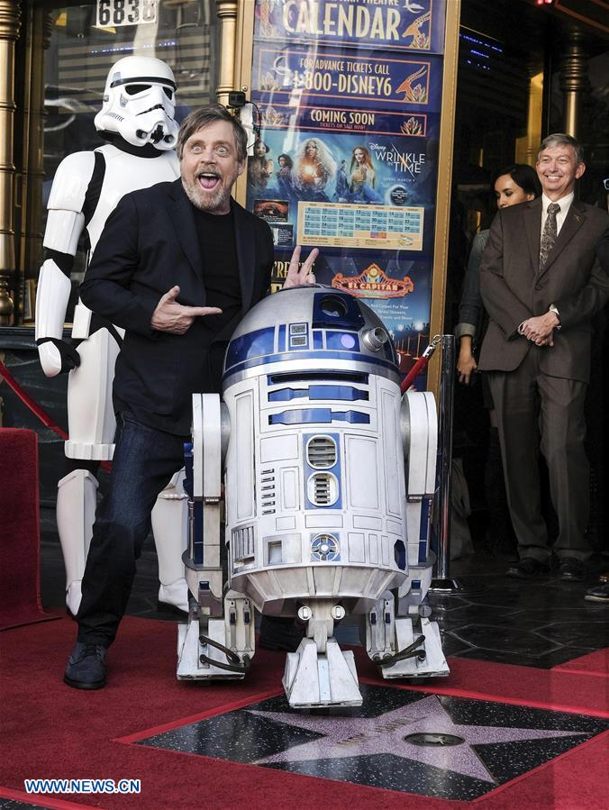 Actor Mark Hamill (L) attends a star honoring ceremony on the Hollywood Walk of Fame in Los Angeles, the United States, March 8, 2018. Mark Hamill was honored with a star on the Hollywood Walk of Fame on Thursday. (Xinhua/Zhao Hanrong)<br/>