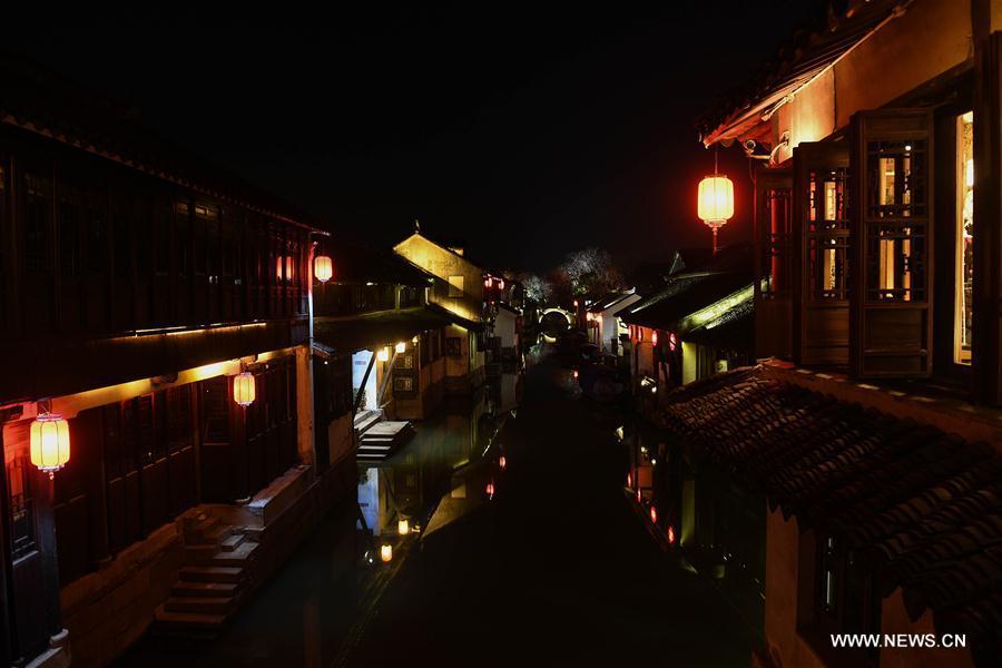 Photo taken on March 9, 2018 shows the night view of the ancient town of Zhouzhuang in Suzhou City, east China's Jiangsu Province. As temperature rises, the water town of Zhouzhuang becomes hot tourist destination. (Xinhua/Ji Chunpeng)