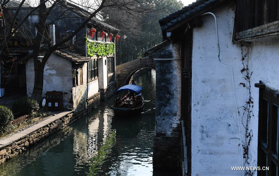 Tourists take sightseeing boats on the river in the ancient town of Zhouzhuang in Suzhou City, east China's Jiangsu Province, March 9, 2018. As temperature rises, the water town of Zhouzhuang becomes hot tourist destination. (Xinhua/Ji Chunpeng)<br/>
