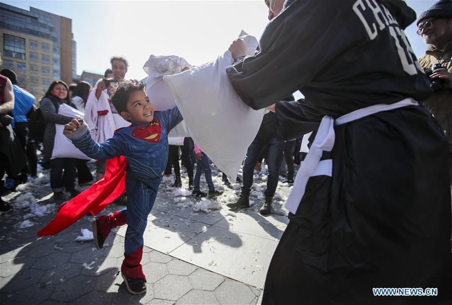 A boy dressed as a superman participates in a pillow fight in New York, the United States, on April 7, 2018. Hundreds of people took part in the annual event to reduce stress and enjoy themselves here on Saturday. (Xinhua/Wang Ying)<br/>