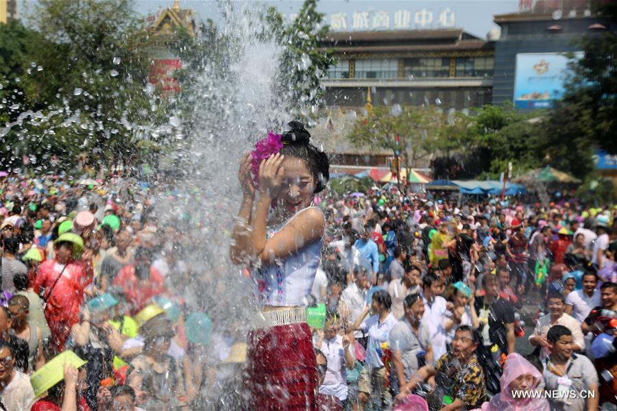 People celebrate the water-sprinkling festival at a square in Jinghong City, Dai Autonomous Prefecture of Xishuangbanna, southwest China's Yunnan Province, April 15, 2018. People sprinkle water to each other to pray for good fortune during the traditional water-sprinkling festival, which is also the New Year festival of the Dai ethnic group. (Xinhua/Shao Bin)