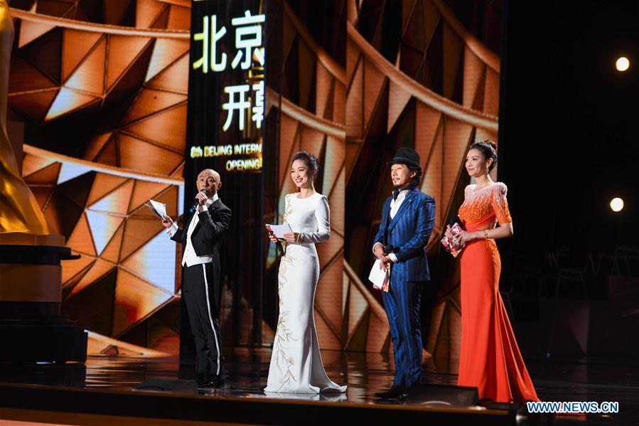 Hosts are seen during opening ceremony of the 8th Beijing International Film Festival (BJIFF) in Beijing, capital of China, April 15, 2018. (Xinhua/Zhang Chenlin)<br/>