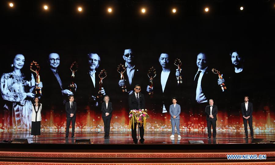 Jury members of the Tiantan Award attend the opening ceremony of the 8th Beijing International Film Festival (BJIFF) in Beijing, capital of China, April 15, 2018. (Xinhua/Yin Gang)<br/>