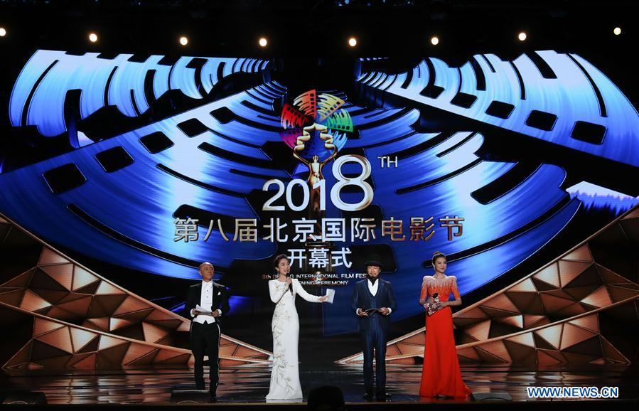 Hosts are seen during the opening ceremony of the 8th Beijing International Film Festival (BJIFF) in Beijing, capital of China, April 15, 2018. (Xinhua/Yin Gang)<br/>