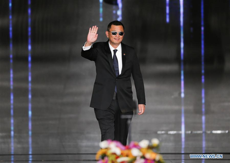 Jury member of the Tiantan Award Wong Kar Wai attends the opening ceremony of the 8th Beijing International Film Festival (BJIFF) in Beijing, capital of China, April 15, 2018. (Xinhua/Meng Dingbo)<br/>