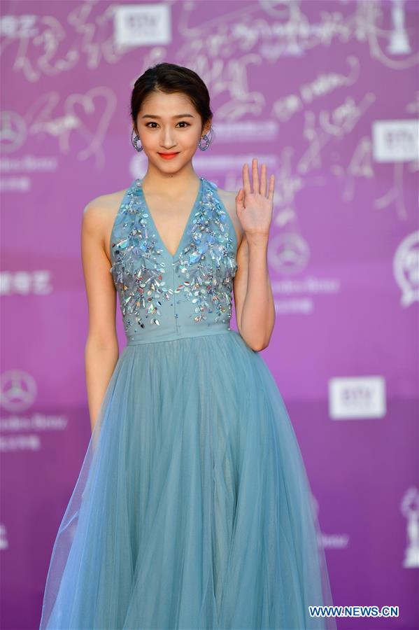 Actress Guan Xiaotong poses on the red carpet for the closing ceremony of the 8th Beijing International Film Festival (BJIFF) in Beijing, capital of China, April 22, 2018. (Xinhua/Jin Liangkuai)