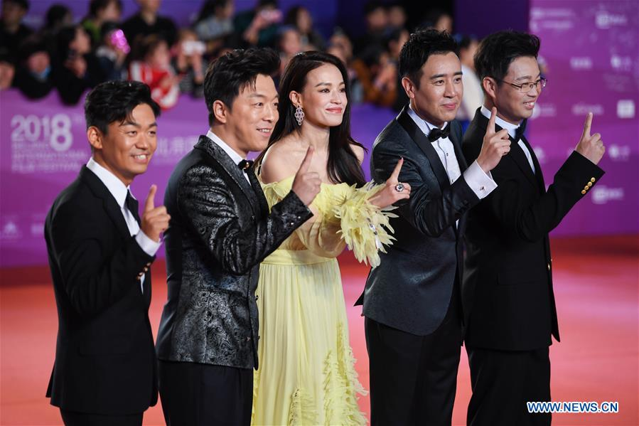 Cast members of the movie &quot;The Island&quot; pose on the red carpet for the closing ceremony of the 8th Beijing International Film Festival (BJIFF) in Beijing, capital of China, April 22, 2018. (Xinhua/Liu Junxi)<br/>