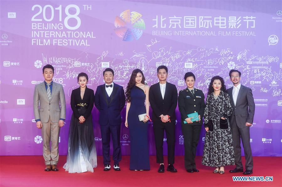Cast members of the movie &quot;Goddesses in the Flames of War&quot; pose on the red carpet for the closing ceremony of the 8th Beijing International Film Festival (BJIFF) in Beijing, capital of China, April 22, 2018. (Xinhua/Jin Liangkuai)<br/>