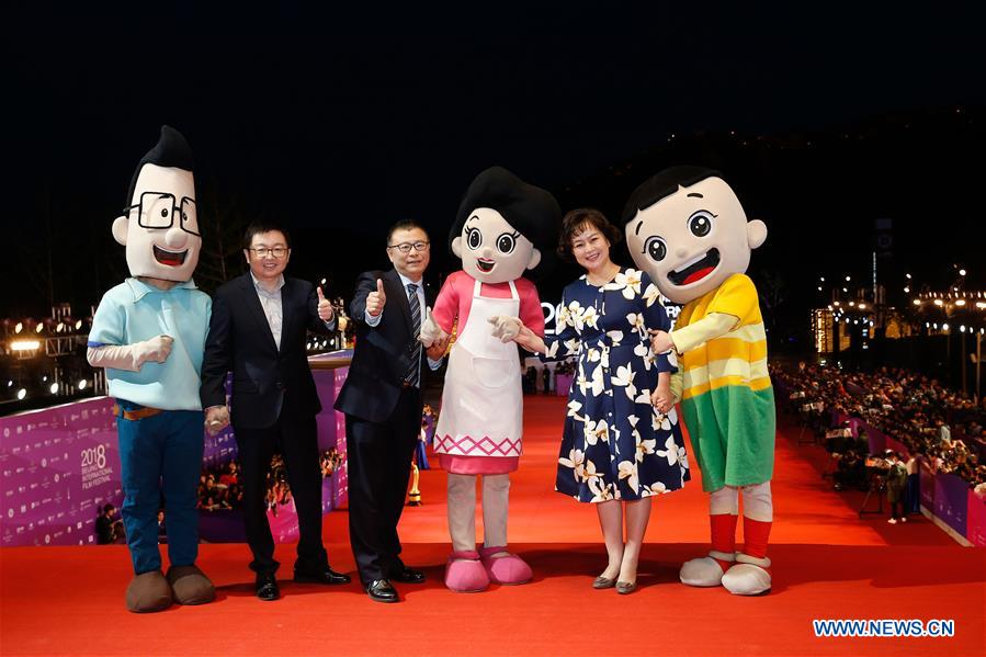 Cast members of the movie &quot;Big Head Son and Little Head Father&quot; pose on the red carpet for the closing ceremony of the 8th Beijing International Film Festival (BJIFF) in Beijing, capital of China, April 22, 2018. (Xinhua/Zhang Yuwei)<br/>