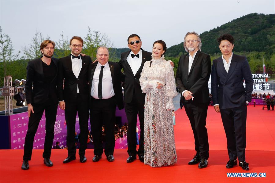 Jury members pose on the red carpet for the closing ceremony of the 8th Beijing International Film Festival (BJIFF) in Beijing, capital of China, April 22, 2018. (Xinhua/Zhang Yuwei)<br/>