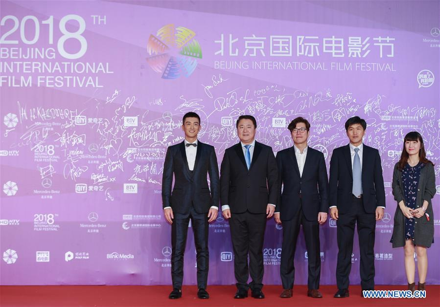 Cast members of the movie &quot;Operation Red Sea&quot; pose on the red carpet for the closing ceremony of the 8th Beijing International Film Festival (BJIFF) in Beijing, capital of China, April 22, 2018. (Xinhua/Cai Yang)<br/>