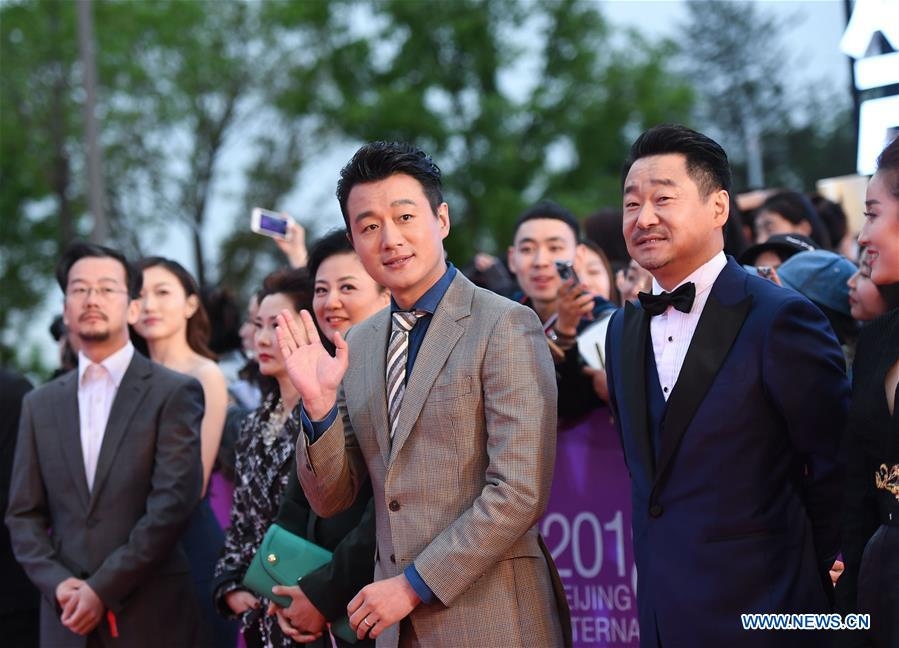 Actors Tong Dawei (front, 1st L) and Wang Jingchun (front, 2nd L) pose on the red carpet for the closing ceremony of the 8th Beijing International Film Festival (BJIFF) in Beijing, capital of China, April 22, 2018. (Xinhua/Purbu Zhaxi)<br/>
