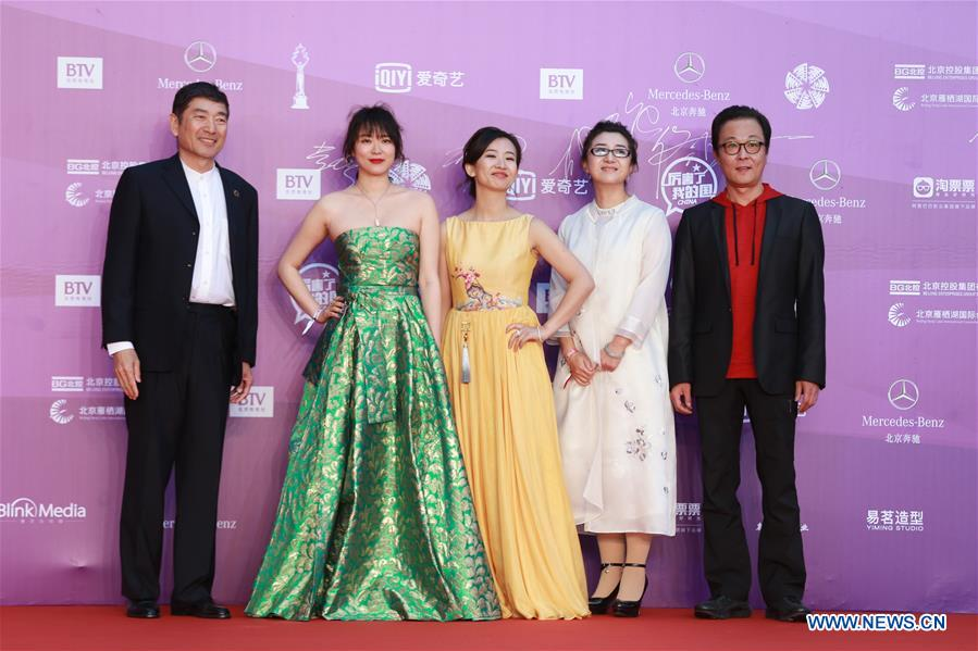 Cast members of the movie &quot;Blood 13&quot; pose on the red carpet for the closing ceremony of the 8th Beijing International Film Festival (BJIFF) in Beijing, capital of China, April 22, 2018. (Xinhua/Cai Yang)<br/>