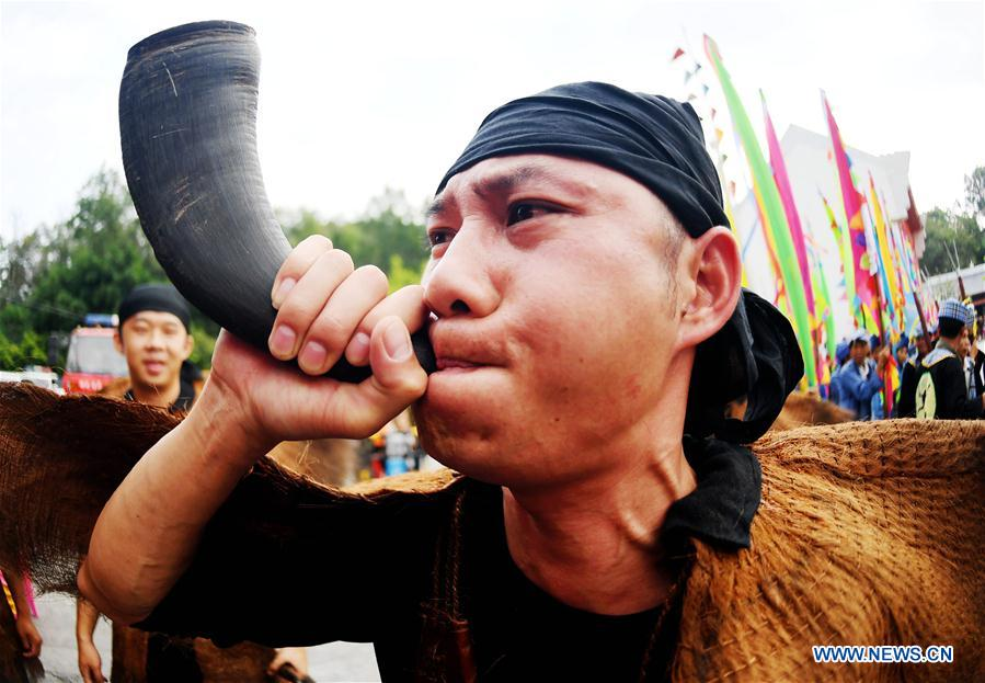 A youth of Zhuang ethnic group blows an ox horn during the Buluotuo folk cultural tourism festival in Tianyang County, Baise City of south China's Guangxi Zhuang Autonomous Region, April 22, 2018. (Xinhua/Zhang Ailin)<br/>