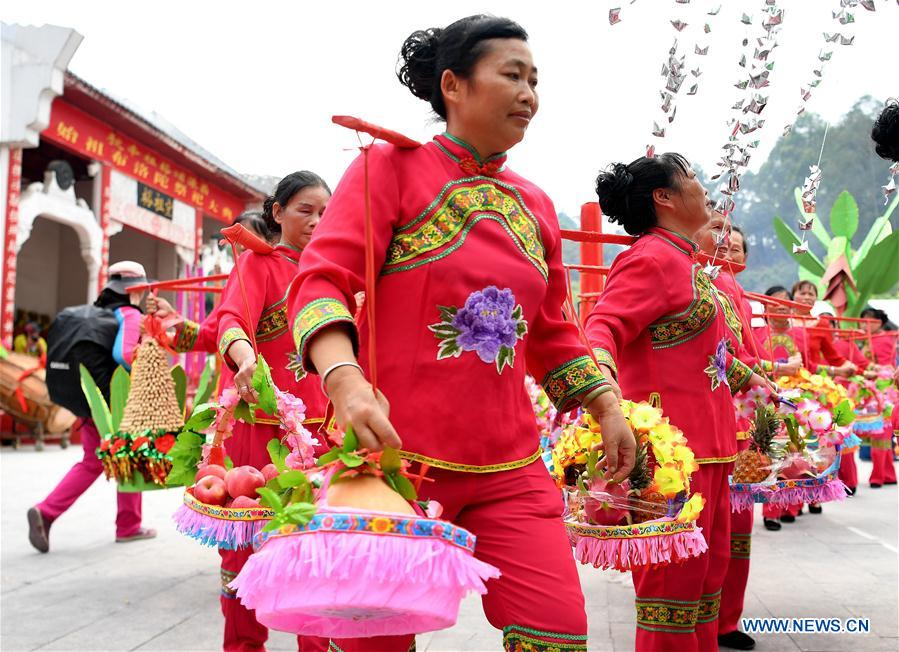 Women of Zhuang ethnic group perform during the Buluotuo folk cultural tourism festival in Tianyang County, Baise City of south China's Guangxi Zhuang Autonomous Region, April 22, 2018. (Xinhua/Zhang Ailin)<br/>