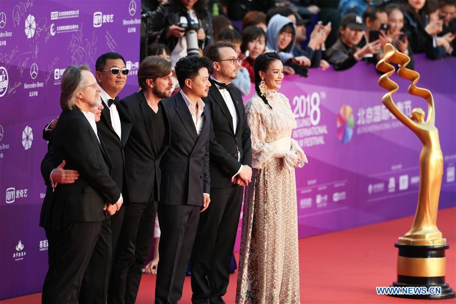 Jury members pose on the red carpet for the closing ceremony of the 8th Beijing International Film Festival (BJIFF) in Beijing, capital of China, April 22, 2018. (Xinhua/Zheng Huansong)<br/>