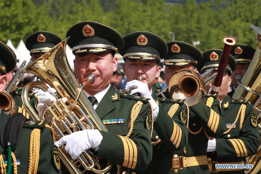The military band of the Chinese People's Liberation Army (PLA) takes part in a military band parade held at the Beijing Olympic Park during a military band festival of the Shanghai Cooperation Organization (SCO), in Beijing, capital of China, April 25, 2018. Military bands from eight countries, namely China, Kyrgyzstan, Pakistan, Russia, Tajikistan, Uzbekistan, India and Belarus, took part in the fifth SCO military band festival. (Xinhua/Ju Zhenhua)The military band of the Chinese People's Armed Police Force takes part in a military band parade held at the Beijing Olympic Park during a military band festival of the Shanghai Cooperation Organization (SCO), in Beijing, capital of China, April 25, 2018. Military bands from eight countries, namely China, Kyrgyzstan, Pakistan, Russia, Tajikistan, Uzbekistan, India and Belarus, took part in the fifth SCO military band festival. (Xinhua/Ju Zhenhua)<br/>