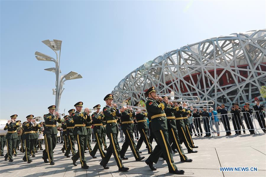 The military band of the Chinese People's Liberation Army (PLA) takes part in a military band parade held at the Beijing Olympic Park during a military band festival of the Shanghai Cooperation Organization (SCO), in Beijing, capital of China, April 25, 2018. Military bands from eight countries, namely China, Kyrgyzstan, Pakistan, Russia, Tajikistan, Uzbekistan, India and Belarus, took part in the fifth SCO military band festival. (Xinhua/Ju Zhenhua)<br/>