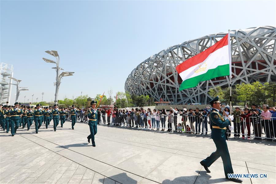 The military band of Tajikistan takes part in a military band parade held at the Beijing Olympic Park during a military band festival of the Shanghai Cooperation Organization (SCO), in Beijing, capital of China, April 25, 2018. Military bands from eight countries, namely China, Kyrgyzstan, Pakistan, Russia, Tajikistan, Uzbekistan, India and Belarus, took part in the fifth SCO military band festival. (Xinhua/Ju Zhenhua)<br/>