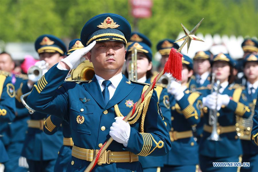 The military band of the Chinese People's Liberation Army (PLA) Air Force takes part in a military band parade held at the Beijing Olympic Park during a military band festival of the Shanghai Cooperation Organization (SCO), in Beijing, capital of China, April 25, 2018. Military bands from eight countries, namely China, Kyrgyzstan, Pakistan, Russia, Tajikistan, Uzbekistan, India and Belarus, took part in the fifth SCO military band festival. (Xinhua/Ju Zhenhua)<br/>