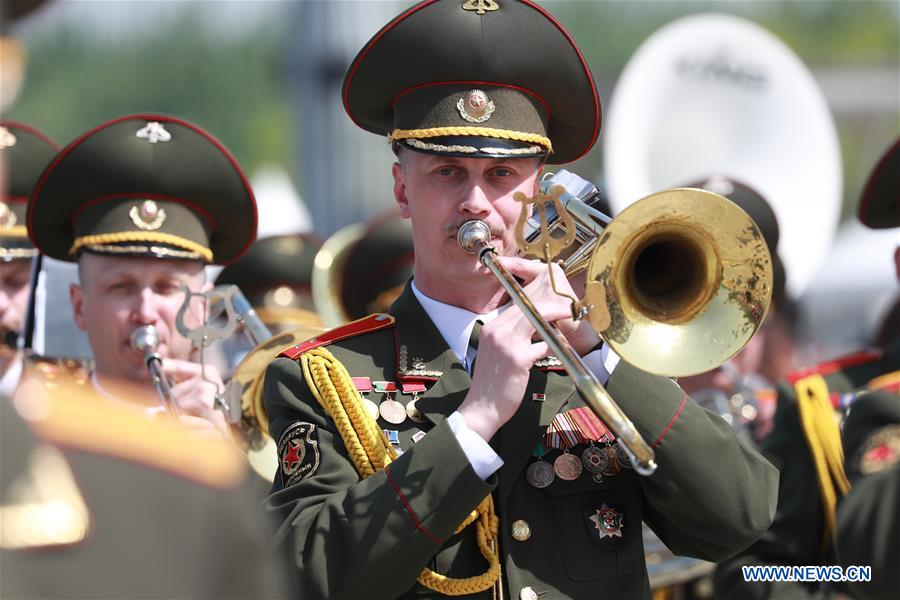 The military band of Belarus takes part in a military band parade held at the Beijing Olympic Park during a military band festival of the Shanghai Cooperation Organization (SCO), in Beijing, capital of China, April 25, 2018. Military bands from eight countries, namely China, Kyrgyzstan, Pakistan, Russia, Tajikistan, Uzbekistan, India and Belarus, took part in the fifth SCO military band festival. (Xinhua/Ju Zhenhua)<br/>