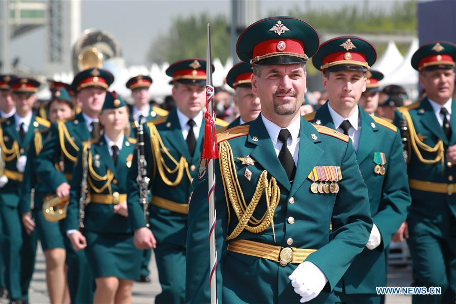 The military band of Russia takes part in a military band parade held at the Beijing Olympic Park during a military band festival of the Shanghai Cooperation Organization (SCO), in Beijing, capital of China, April 25, 2018. Military bands from eight countries, namely China, Kyrgyzstan, Pakistan, Russia, Tajikistan, Uzbekistan, India and Belarus, took part in the fifth SCO military band festival. (Xinhua/Ju Zhenhua)<br/>