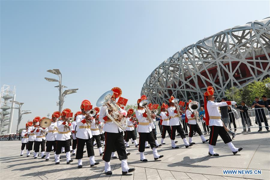 The military band of India takes part in a military band parade held at the Beijing Olympic Park during a military band festival of the Shanghai Cooperation Organization (SCO), in Beijing, capital of China, April 25, 2018. Military bands from eight countries, namely China, Kyrgyzstan, Pakistan, Russia, Tajikistan, Uzbekistan, India and Belarus, took part in the fifth SCO military band festival. (Xinhua/Ju Zhenhua)<br/>