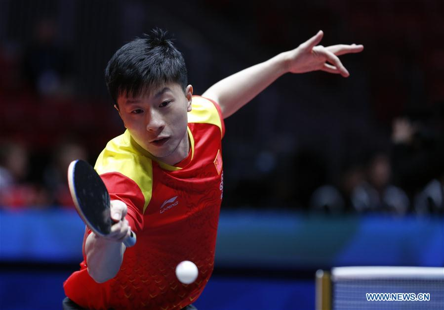 Ma Long of China returns to Choe Il of Democratic People's Republic of Korea (DPRK) at the fifth round of Men's group match during the 2018 World Team Table Tennis Championships in Halmstad, Sweden, May 2, 2018. Ma won the game with 3-0, and team China won the match with 3-0. (Xinhua/Ye Pingfan)<br/>