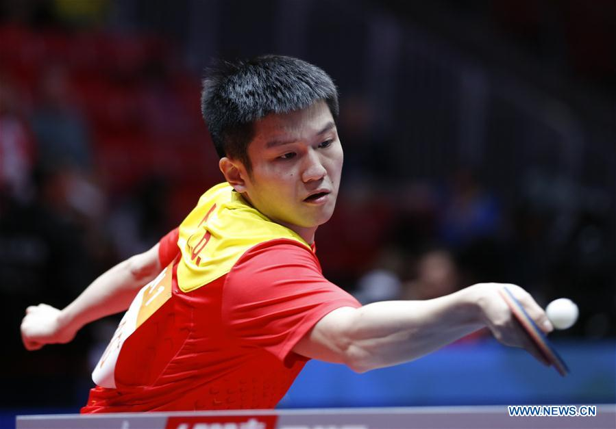 Fan Zhendong of China returns to Pak Sin Hyok of Democratic People's Republic of Korea (DPRK) at the fifth round of Men's group match during the 2018 World Team Table Tennis Championships in Halmstad, Sweden, May 2, 2018. Fan won the game with 3-0, and team China won the match with 3-0. (Xinhua/Ye Pingfan)<br/>
