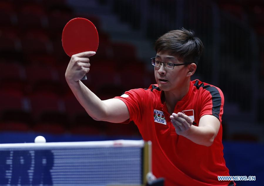 Poh S. F. Ethan of Singapore returns to Mizutani Jun of Japan at the fifth round of Men's group match during the 2018 World Team Table Tennis Championships in Halmstad, Sweden, May 2, 2018. Harimoto won the game with 3-0, and team Japan won the match with 3-0. (Xinhua/Ye Pingfan)<br/>
