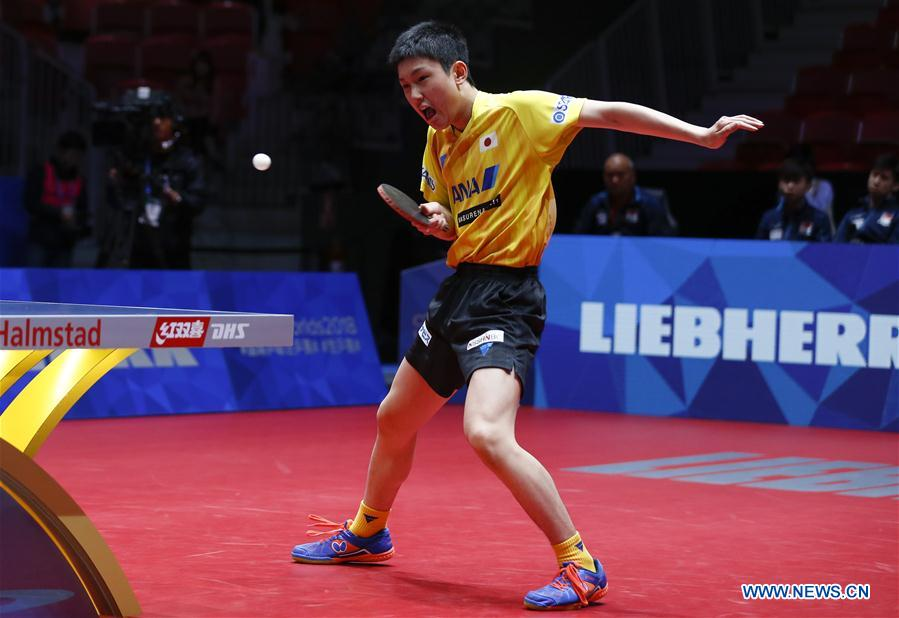 Harimoto Tomokazu of Japan returns to Gao Ning of Singapore at the fifth round of Men's group match during the 2018 World Team Table Tennis Championships in Halmstad, Sweden, May 2, 2018. Harimoto won the game with 3-0, and team Japan won the match with 3-0. (Xinhua/Ye Pingfan)