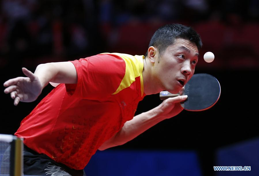 Xu Xin of China serves to Kang Wi Hun of Democratic People's Republic of Korea (DPRK) at the fifth round of Men's group match during the 2018 World Team Table Tennis Championships in Halmstad, Sweden, May 2, 2018. Xu won the game with 3-0, and team China won the match with 3-0. (Xinhua/Ye Pingfan)<br/>