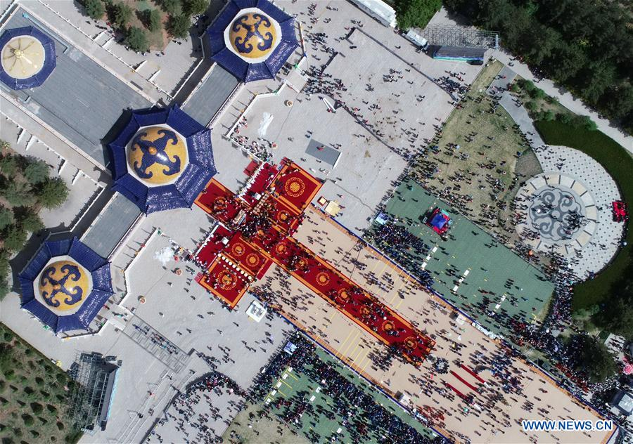 A grand memorial ritual for the 13th-century great conqueror Genghis Khan is held at the mausoleum of Genghis Khan in Ejin Horo Qi, north China's Inner Mongolia Autonomous Region, May 6, 2018. The annual spring ceremony for Genghis Khan has been practiced for nearly 800 years. Worshippers stepped into the shrine, offering hada, a ceremonial silk scarf, and tea bricks, among other offerings. Genghis Khan's relics are enshrined at the site. (Xinhua/Darkhan)<br/>