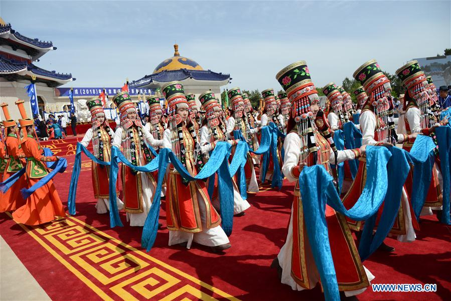 People attend a grand memorial ritual for the 13th-century great conqueror Genghis Khan at the mausoleum of Genghis Khan in Ejin Horo Qi, north China's Inner Mongolia Autonomous Region, May 6, 2018. The annual spring ceremony for Genghis Khan has been practiced for nearly 800 years. Worshippers stepped into the shrine, offering hada, a ceremonial silk scarf, and tea bricks, among other offerings. Genghis Khan's relics are enshrined at the site. (Xinhua/Zou Yu)<br/>