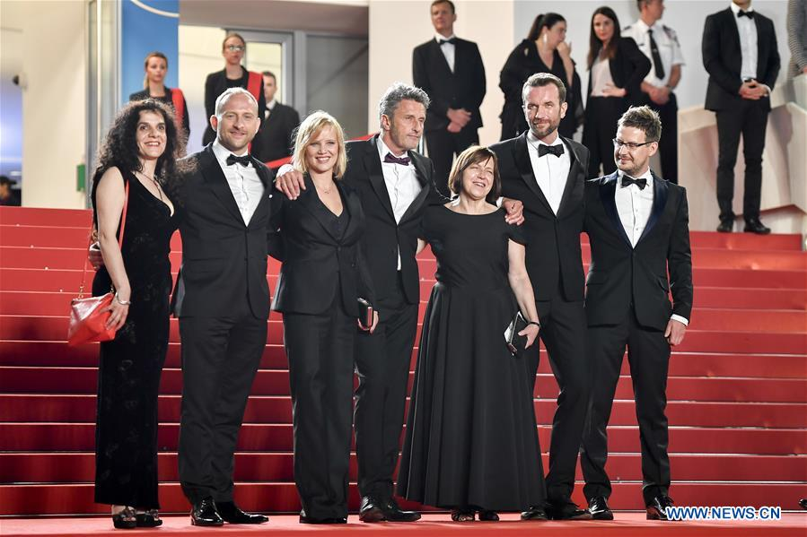 Producer Tanya Seghatchian, actor Borys Szyc, actress Joanna Kulig, director Pawel Pawlikowski, producer Ewa Puszczynska, actor Tomasz Kot and cinematographer Lukasz Zal (from L to R) of the film &quot;Cold War&quot; pose for photos during the premiere red carpet of &quot;Cold War&quot; at the 71st Cannes International Film Festival in Cannes, France, on May 10, 2018. The 71st Cannes International Film Festival is held from May 8 to May 19. (Xinhua/Chen Yichen)<br/>