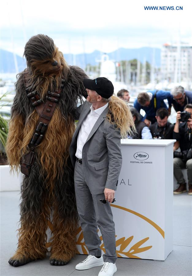 "Director Ron Howard (R) and character Chewbacca of the film ""Solo: A Star Wars Story"" pose during a photocall at the 71st Cannes International Film Festival in Cannes, France, on May 15, 2018. The 71st Cannes International Film Festival is held from May 8 to May 19. (Xinhua/Luo Huanhuan)"