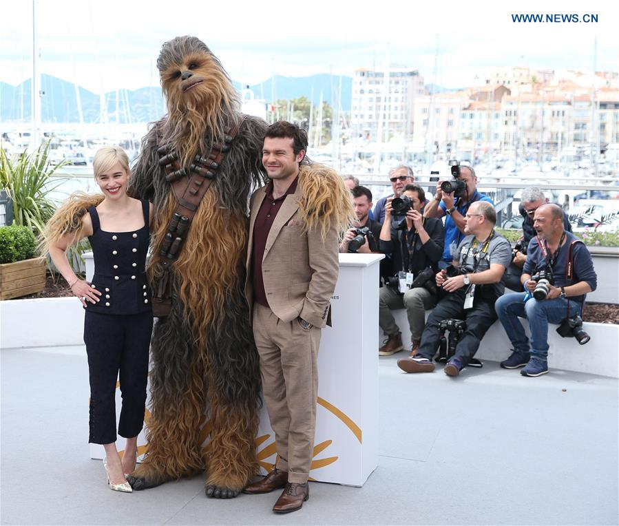 Emilia Clarke (L), character Chewbacca (C) and Alden Ehrenreich of the film &quot;Solo: A Star Wars Story&quot; pose during a photocall at the 71st Cannes International Film Festival in Cannes, France, on May 15, 2018. The 71st Cannes International Film Festival is held from May 8 to May 19. (Xinhua/Luo Huanhuan)<br/>
