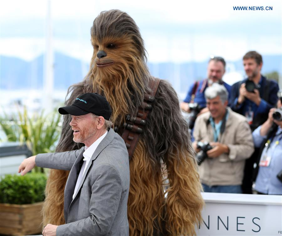 Director Ron Howard and character Chewbacca of the film &quot;Solo: A Star Wars Story&quot; pose during a photocall at the 71st Cannes International Film Festival in Cannes, France, on May 15, 2018. The 71st Cannes International Film Festival is held from May 8 to May 19. (Xinhua/Luo Huanhuan)<br/>