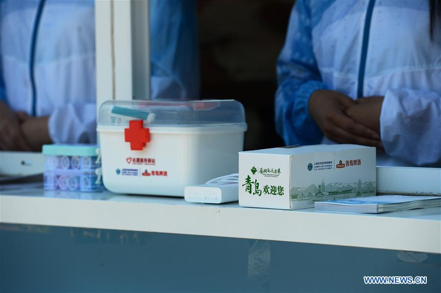 Photo shows the supplies stored at a volunteer service station at the May Fourth Square in Qingdao, east China's Shandong Province, June 3, 2018. The 18th Shanghai Cooperation Organization (SCO) Summit is scheduled for June 9-10 in Qingdao. Volunteers are easily seen on the street. (Xinhua/Sadat)<br/>