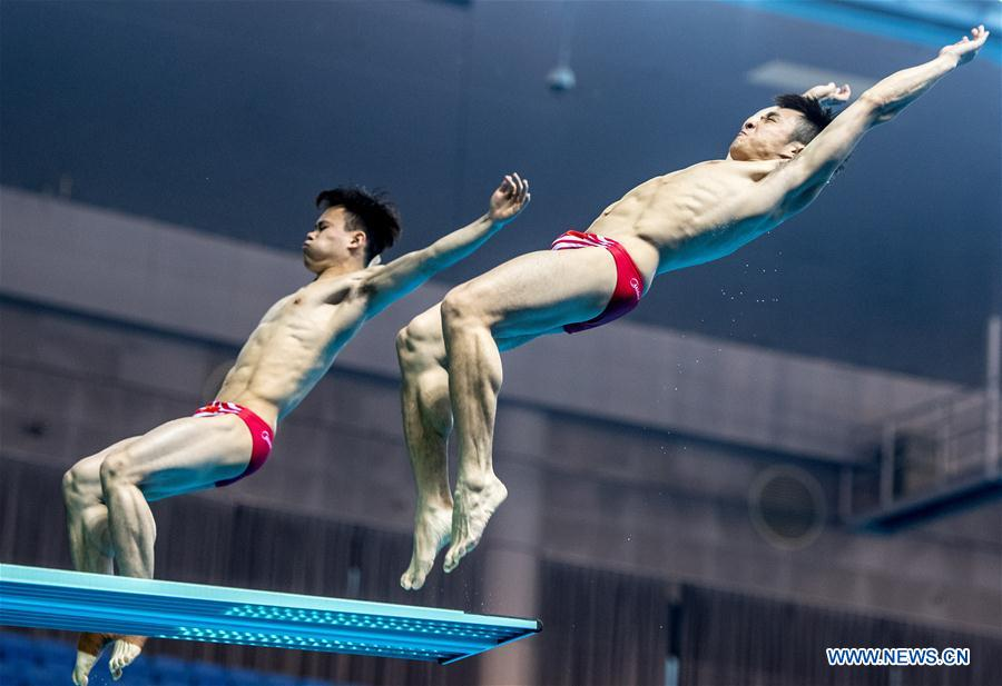 China's Cao Yuan (R) and Xie Siyi compete during the men's 3m springboard synchronised final at the FINA Diving World Cup 2018 in Wuhan, central China's Hubei Province, on June 5, 2018. Cao Yuan and Xie Siyi claimed the title with a total of 448.74 points. (Xinhua/Xiong Qi)<br/>