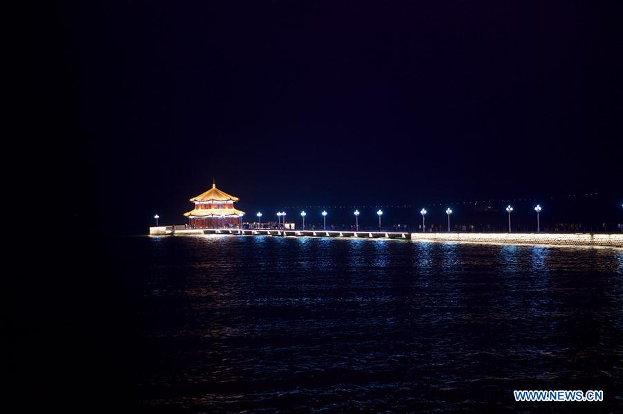 Photo taken on June 4, 2018 shows the night view of Zhanqiao Pier in Qingdao, east China's Shandong Province. The 18th Shanghai Cooperation Organization (SCO) Summit is scheduled for June 9 to 10 in Qingdao. (Xinhua/Jiang Kehong)<br/>