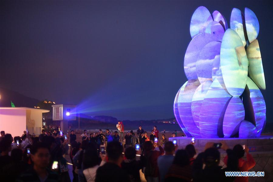 People watch a light show in Qingdao, east China's Shandong Province, June 4, 2018. The 18th Shanghai Cooperation Organization (SCO) Summit is scheduled for June 9 to 10 in Qingdao. (Xinhua/Jin Liangkuai)<br/>