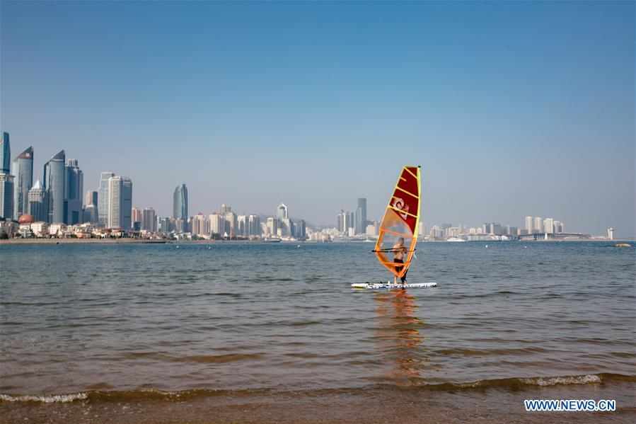 A man goes windsurfering in Qingdao, east China's Shandong Province, May 4, 2018. The 18th Shanghai Cooperation Organization (SCO) Summit is scheduled for June 9 to 10 in Qingdao. (Xinhua/Zhang Cheng)<br/>