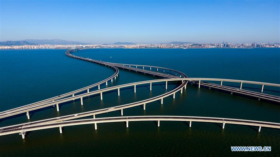 Aerial photo taken on June 1, 2018 shows the Qingdao Jiaozhou Bay Bridge in Qingdao, east China's Shandong Province. The 36.48-km cross-sea bridge connects the urban district of Qingdao City to its Huangdao district. (Xinhua/Guo Xulei)<br/>